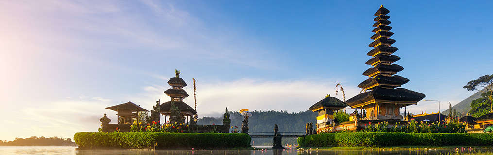 A traditional Indonesian temple and its surrounds at dusk.